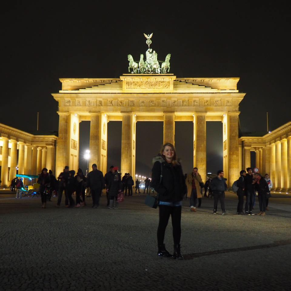 A lady standing in from the Brandenburg gate in Berlin, a popular destination when spending 2 weeks travelling across Europe
