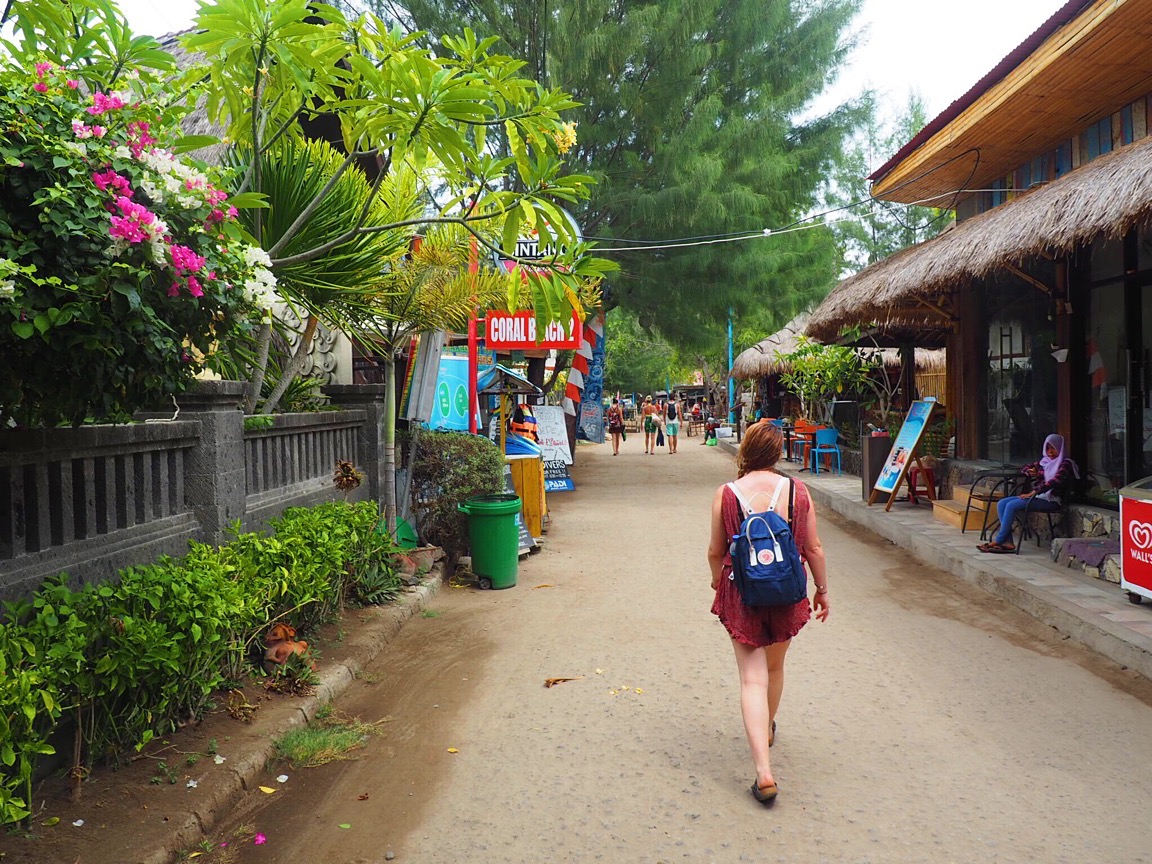 lady walking in gili T