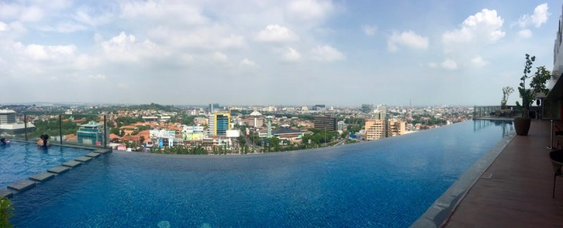 view from the rooftop swimming pool at the louis kienne hotel, indonesia