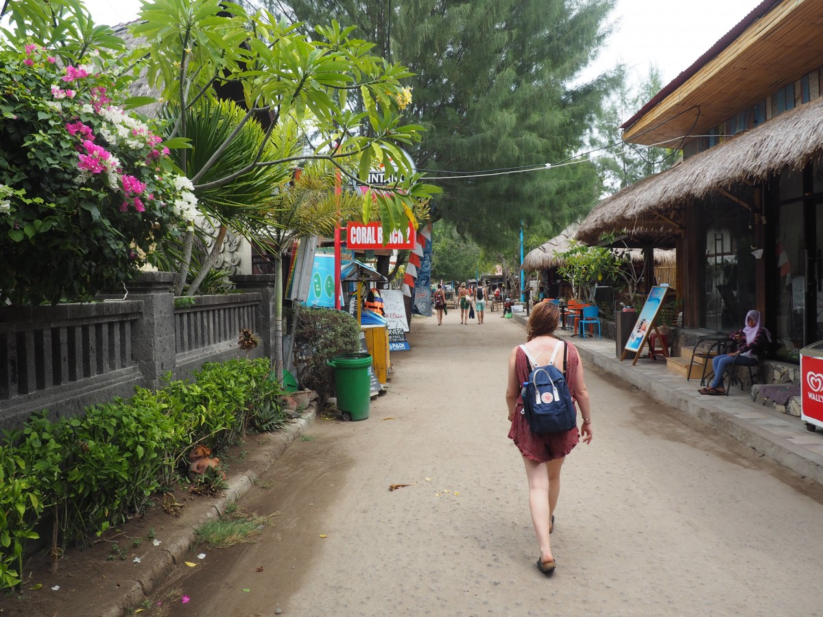 lady walking through Gili T, Indonesia. Travelling from Bali to the Gili Islands is a popular route for both holidaymakers and backpackers