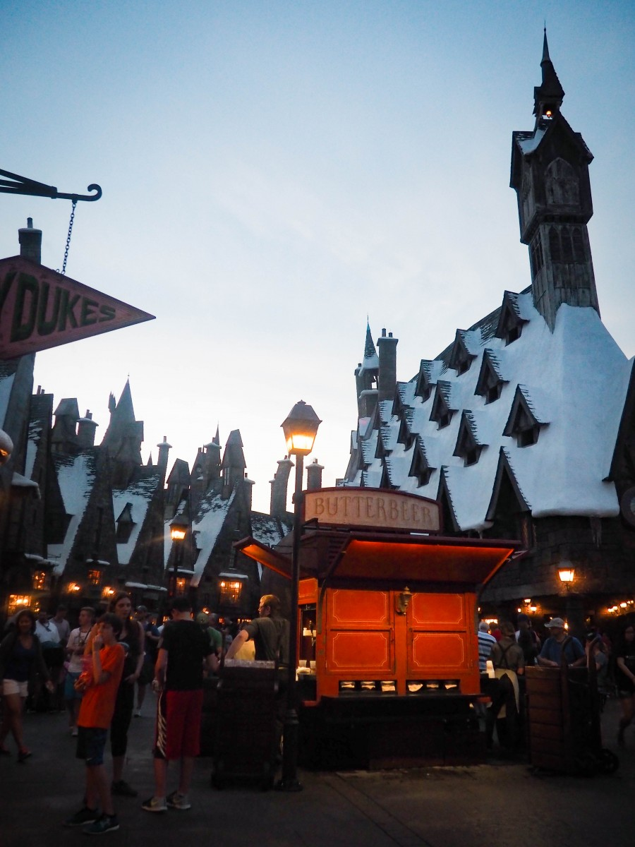 A snowy Hogsmeade and Butterbeer cart at Universal Studios Orlando