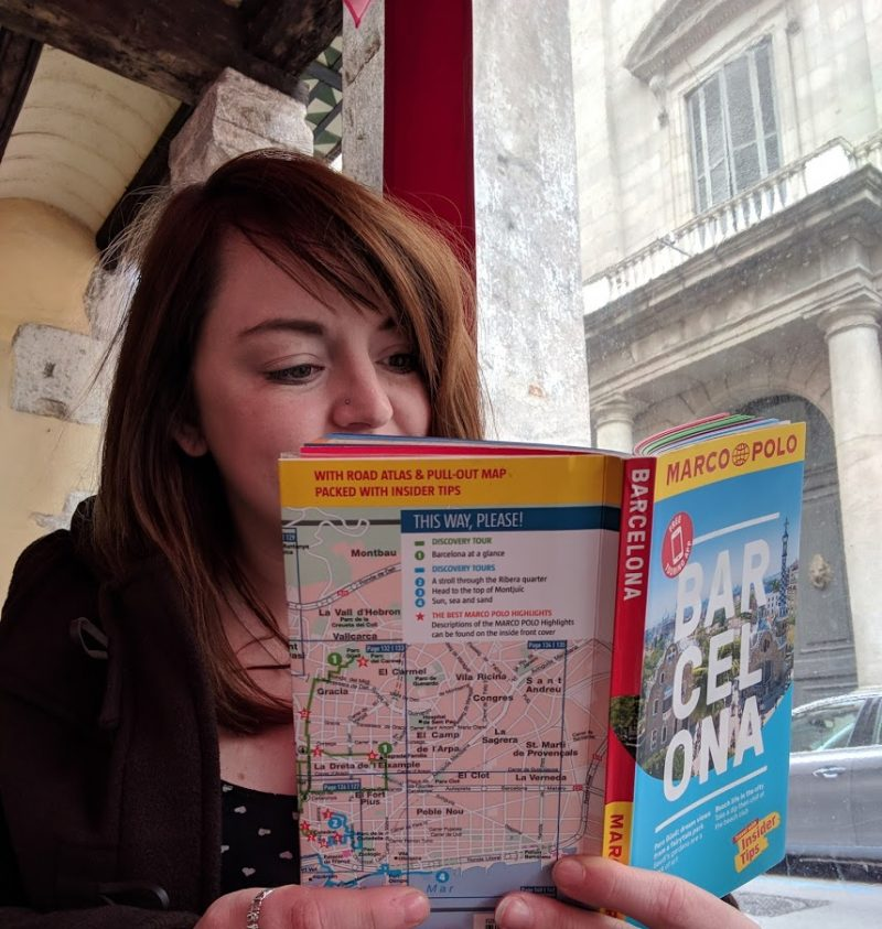 lady reading barcelona guide