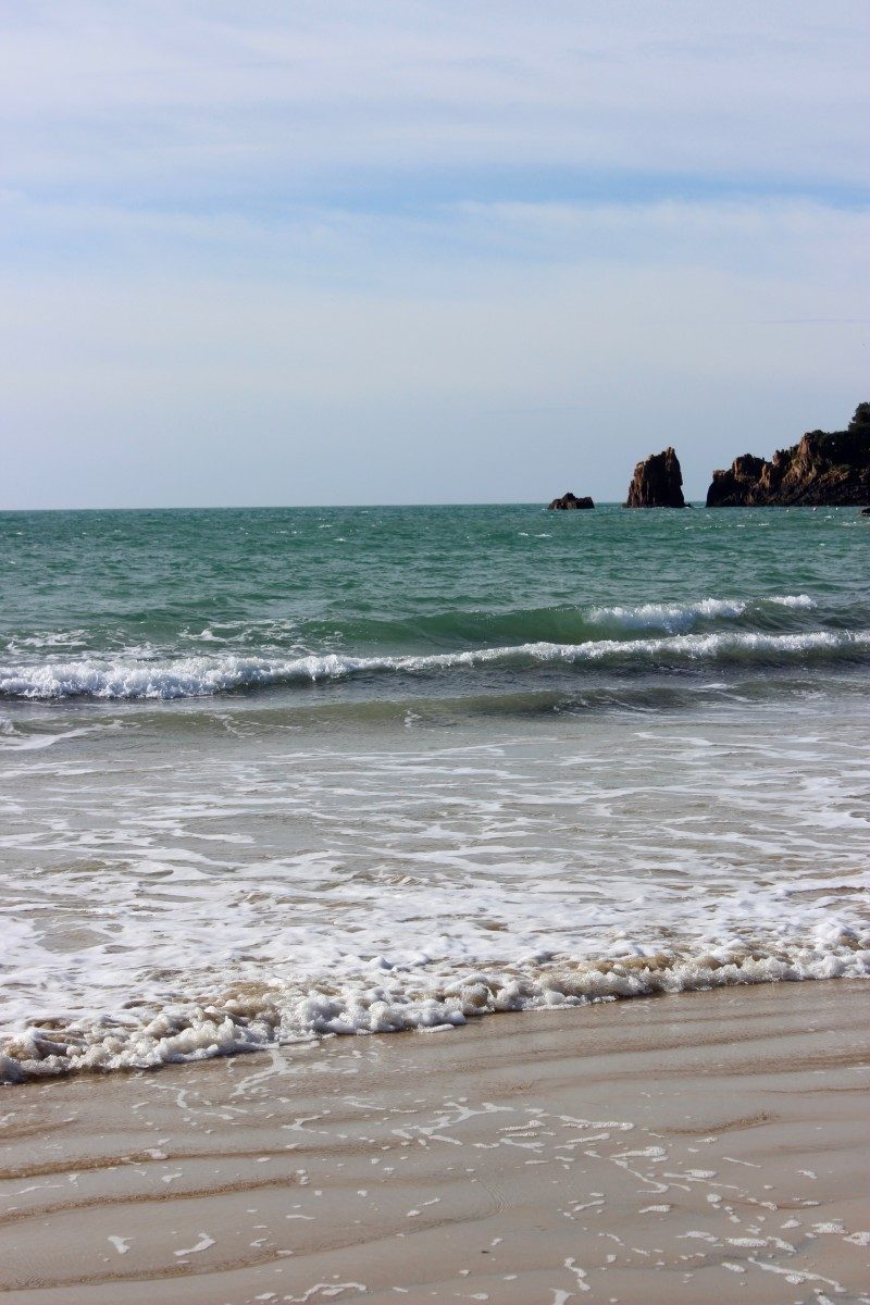 waves of st brelades bay beach in jersey