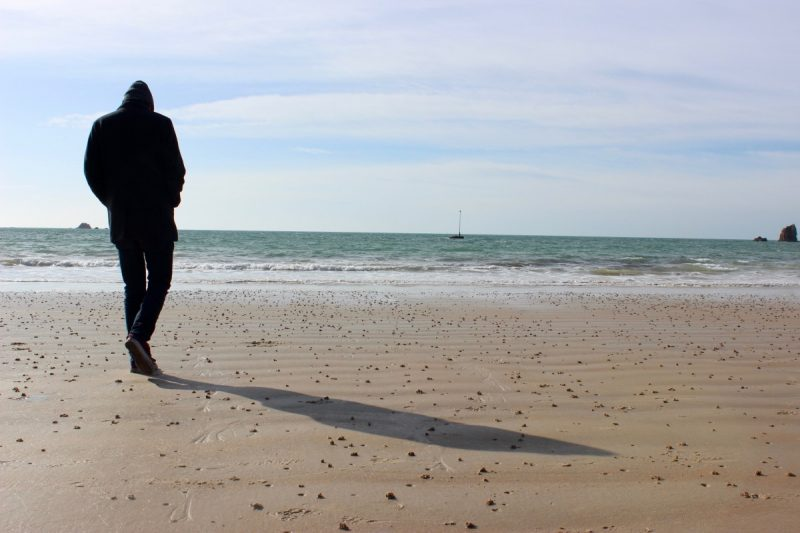 man walking on beach in jersey