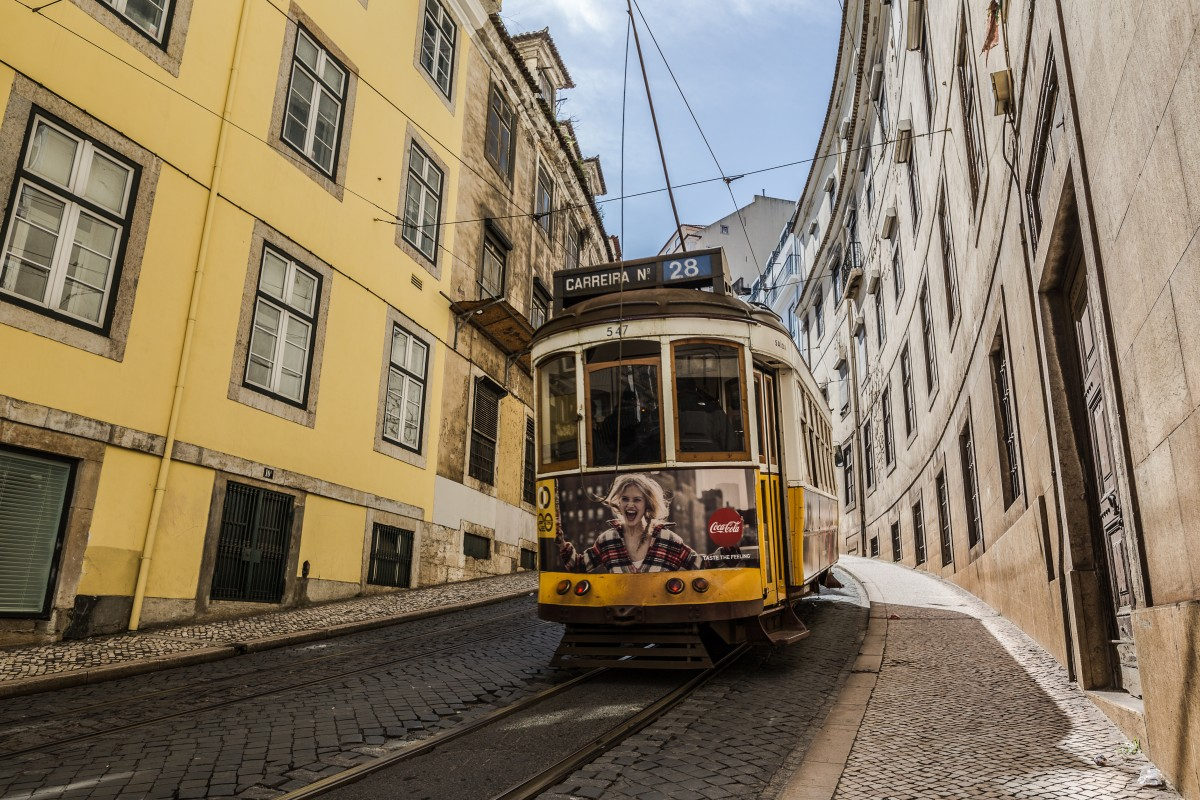A tram in the streets of Lisbon, Portugal. A popular destination on a European train travel itinerary