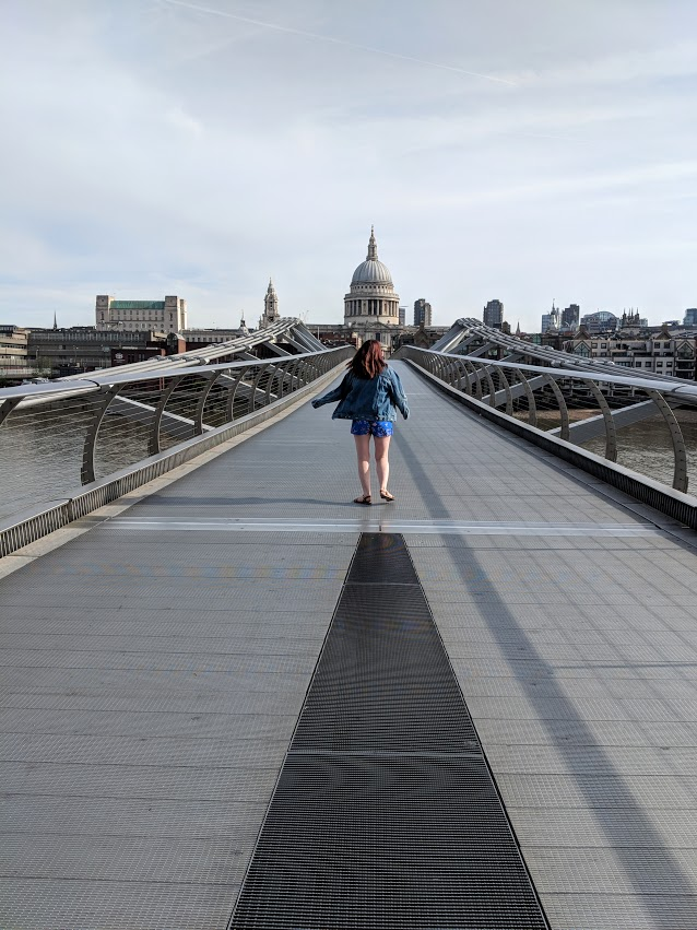 A lady walking down an empty Millennium Bridge in Central London