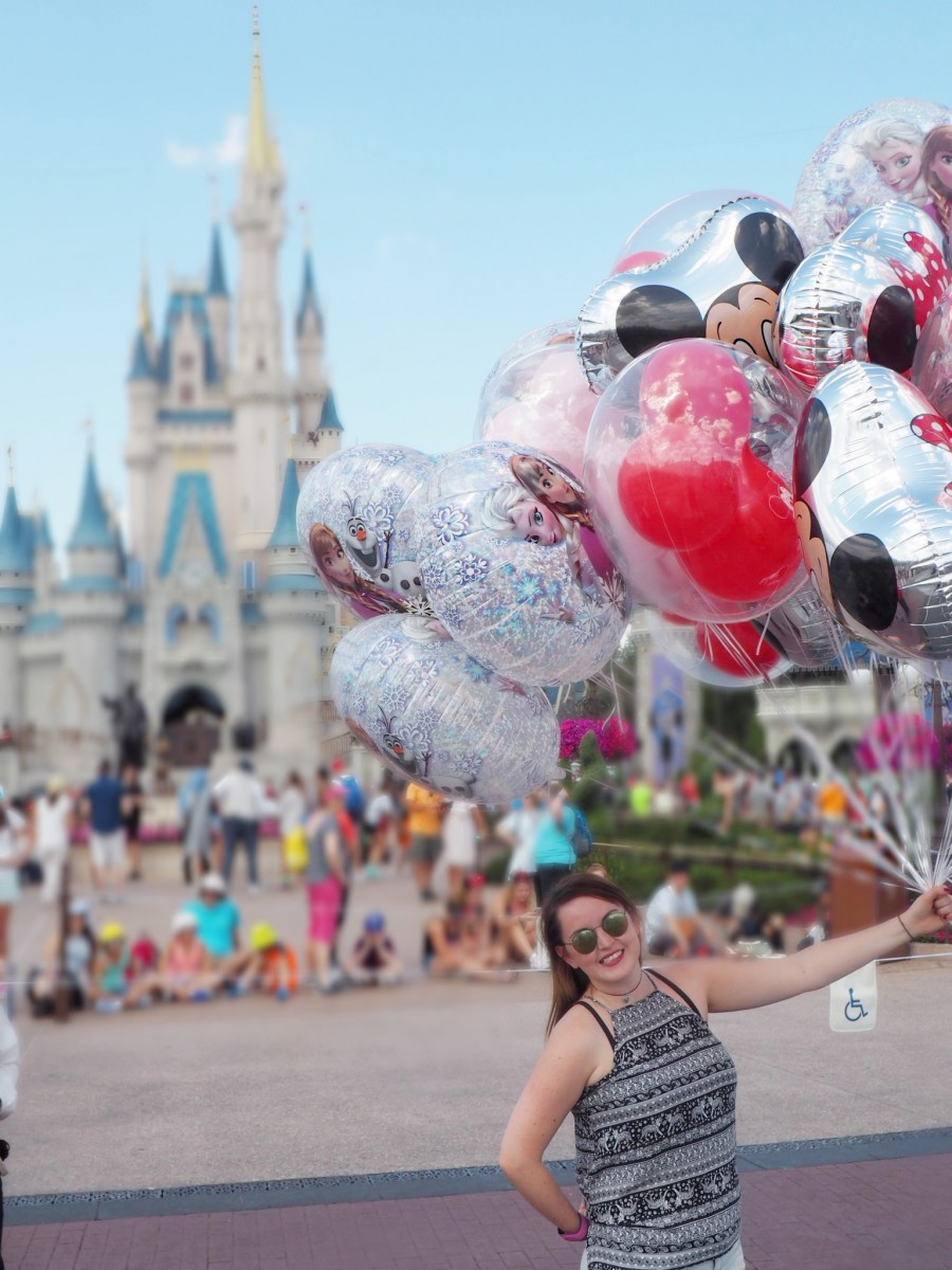 Talk to disney world cast members to get the iconic balloon photo in front of the castle