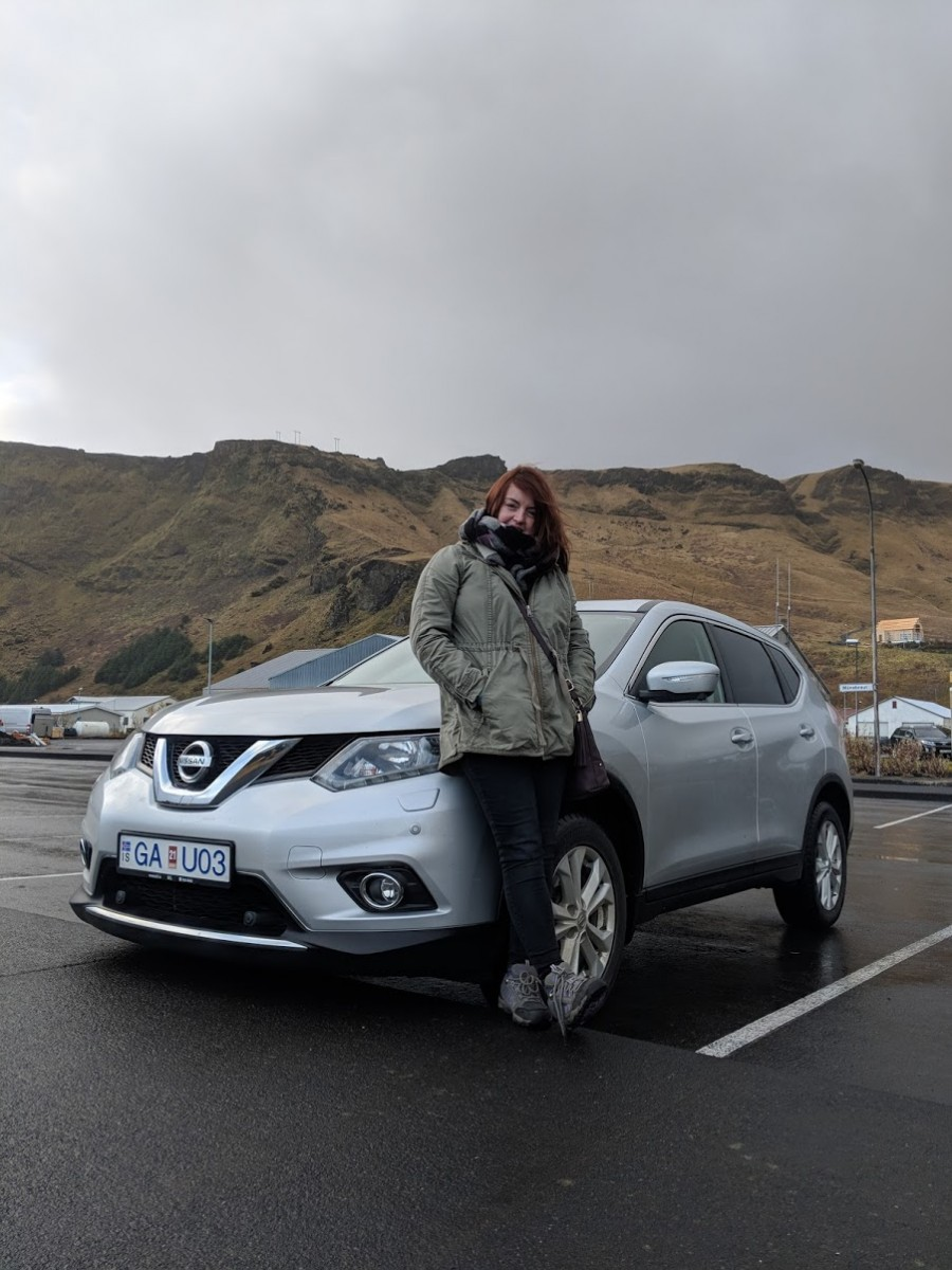 lady stand by car in iceland