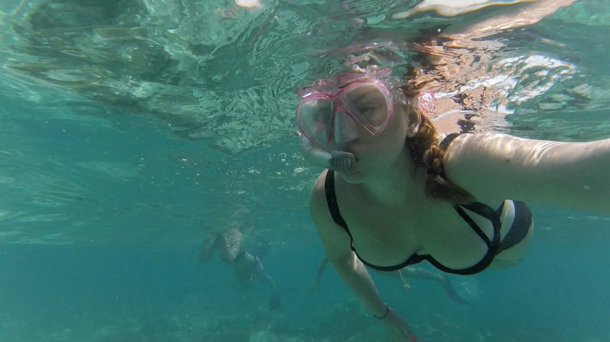 lady snorkelling in Gili T looking for turtles
