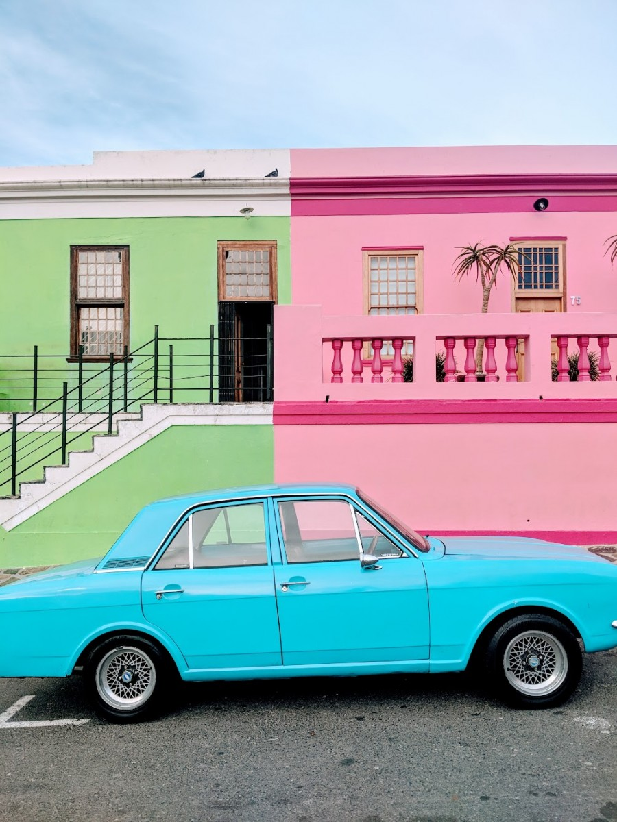 the coloured houses of bo kaap with a vintage blue car