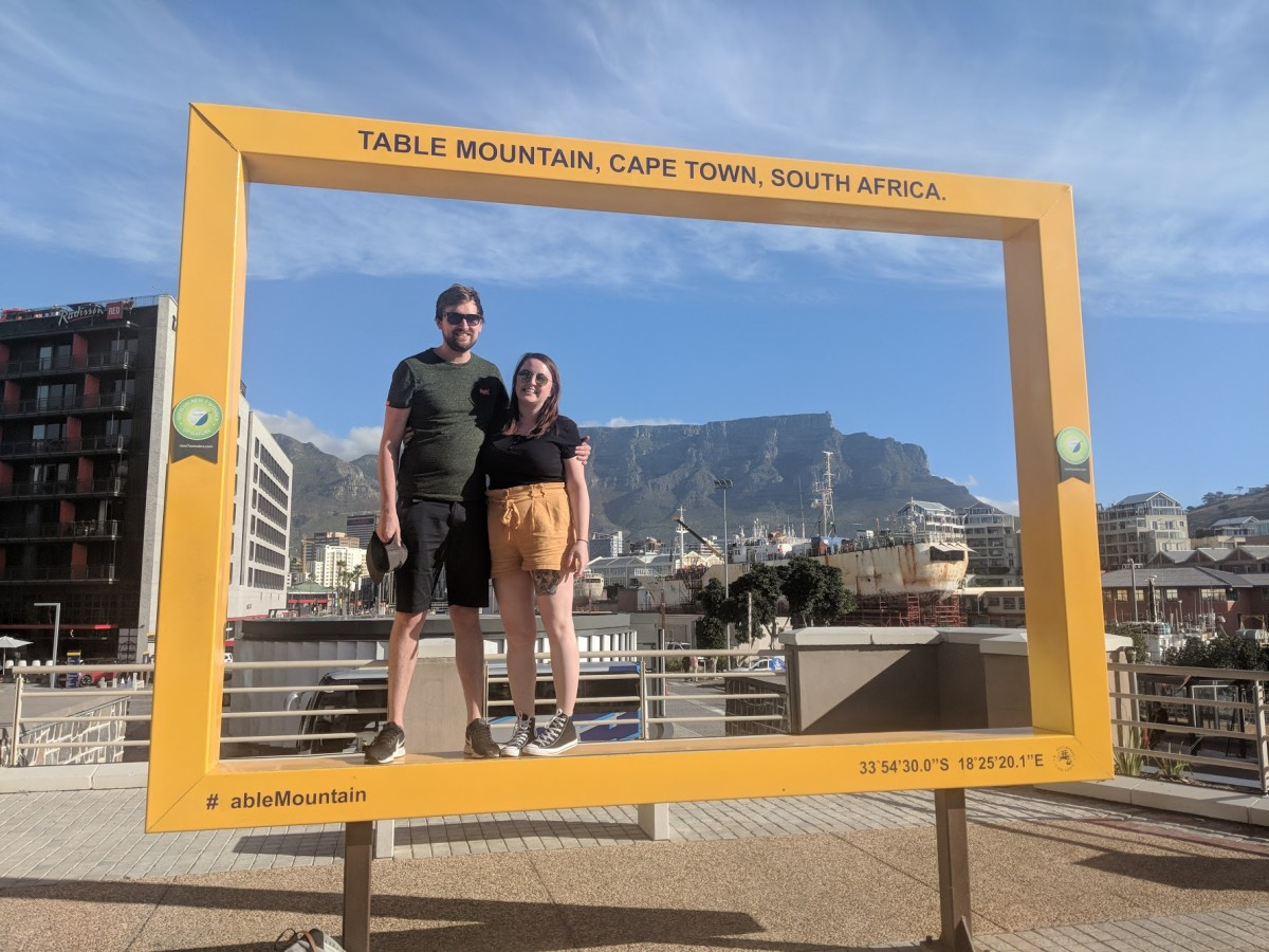 couple standing in front of table mountain during 3 days in cape town