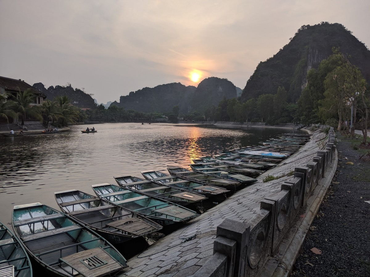 sunset on the river in tam coc, vietnam