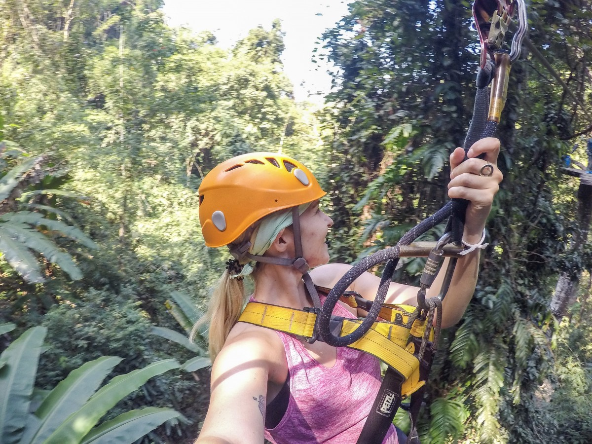 person on flight of the gibbon zipline in chiang mai thailand