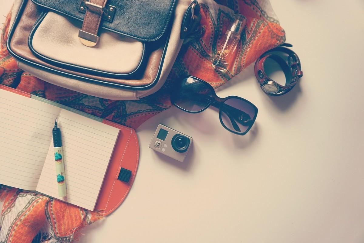 flatlay of long haul flight essentials