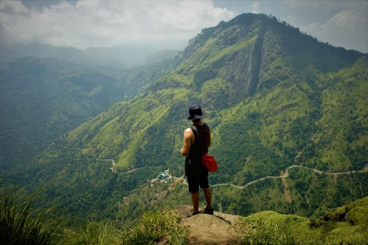 man at the summit of little adams peak , sri lanka