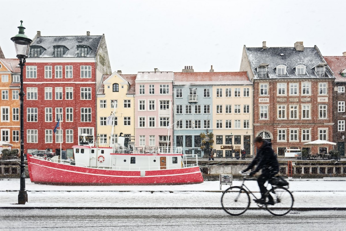 a photo of nyhavn, copenhagen in winter with snow