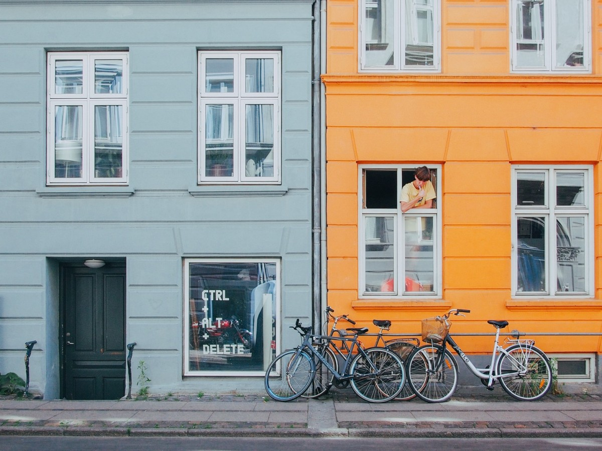 colourful houses in copenhagrn with bikes infront
