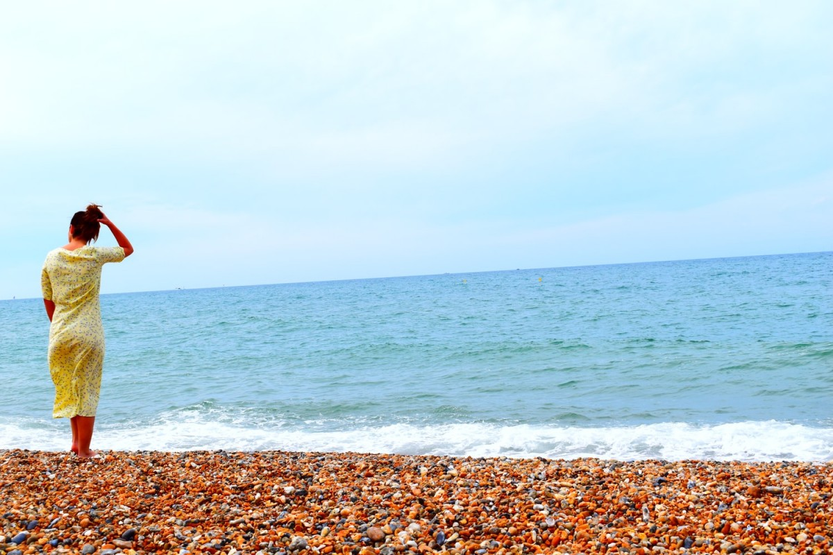 lady standing on brighton beach