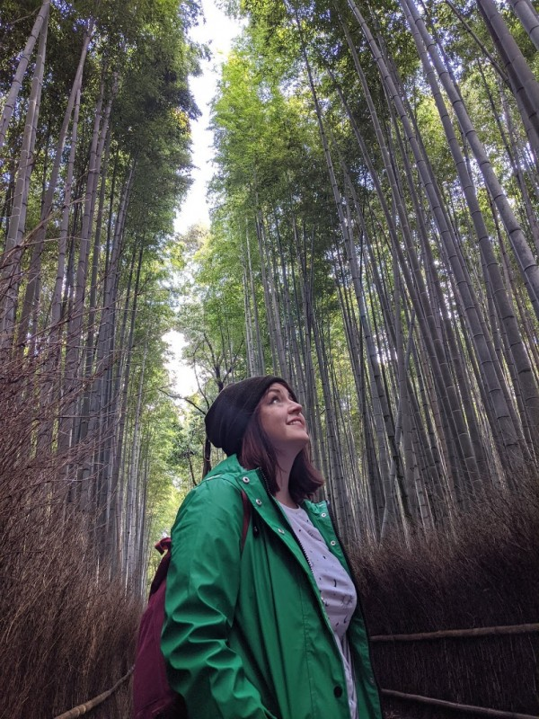 lady standing in the bamboo forest in kyoto, japan